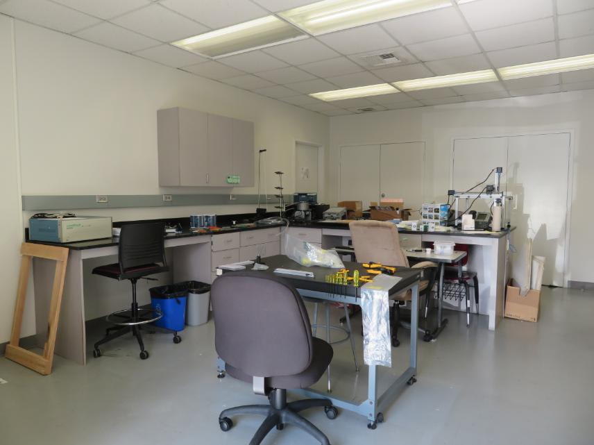 An empty science lab with a chair in the center