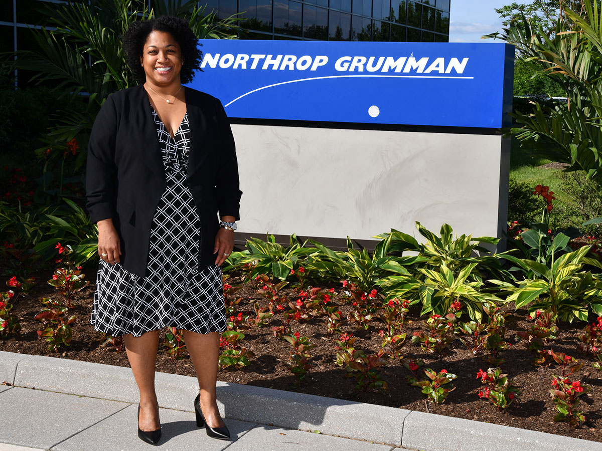 Candace Givens w Northrop Sign